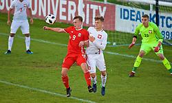 BANGOR, WALES - Monday, October 15, 2018: Wales' Issak Davies (L) and Poland's Michal Ozga during the UEFA Under-19 International Friendly match between Wales and Poland at the VSM Bangor Stadium. (Pic by Paul Greenwood/Propaganda)