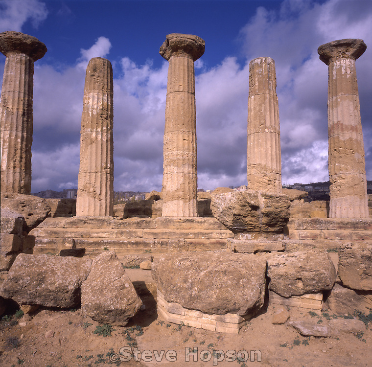 A row ancient Greek columns stands among the remains of a Doric temple dating from the 5th century BC in the Valley of the Temples at Agrigento, Sicily, November 22, 2002.