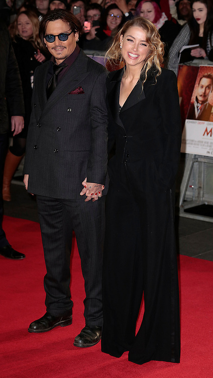 Jan 19, 2015 -'Mortdecai' - UK Premiere - Red Carpet Arrivals at Empire,  Leicester Square, London<br /> <br /> Pictured: Johnny Depp and Amber Heard<br /> ©Exclusivepix Media