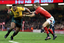 Australia's Samu Kerevi (centre) is tackled by Wales' Liam Williams (right) during the Autumn International at the Principality Stadium, Cardiff.