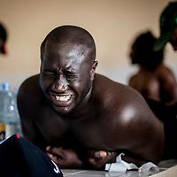 11/06/2013. Stade Iba Mar Diop, Dakar, Senegal. Le joueur Aboubakary Signaté de l'équipe de rugby du Senegal reçoit un massage avant de disputer le premier match de la demi-finale de la Coupe d'Afrique des Nations B contre la Namibie. ©Sylvain Cherkaoui