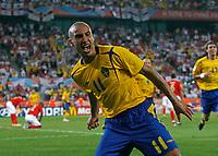 Photo: Glyn Thomas.<br />Sweden v England. FIFA World Cup 2006. 20/06/2006.<br /> Sweden's Henrik Larsson celebrates scoring his side's second goal.
