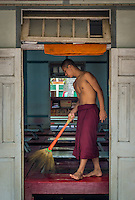 MANDALAY, MYANMAR - CIRCA DECEMBER 2013: Monk cleaning lunch quarters in the Mahar Gandar Yone monastery in Amarpura
