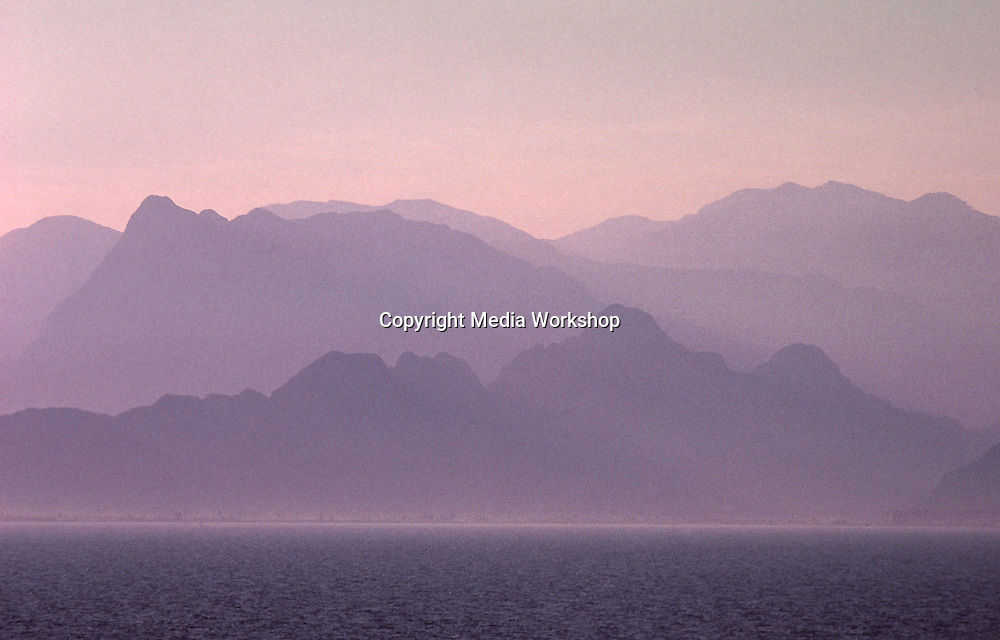 Huge, hazy mountain range over Mediterranean sea west of Antalya.