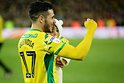Norwich City midfielder Emi Buendia (17)   celebrates with his baby after the EFL Sky Bet Championship match between Norwich City and Blackburn Rovers at Carrow Road, Norwich, England on 27 April 2019.