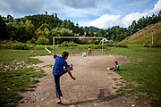 """Children are playing soccer at the Roma part of the district """"Podsadek"""". The town of Stara Lubovna has a population of 16350, of whom 2 060 (13%) are of Roma origin. The majority of Roma live in the Podsadek district, where 980 (74%) out of 1330 inhabitants are Roma."""