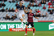 SYDNEY, AUSTRALIA - APRIL 27: Melbourne Victory forward Ola Toivonen (11) heads the ball in front of Western Sydney Wanderers defender Raul Llorente (24) at round 27 of the Hyundai A-League Soccer between Western Sydney Wanderers FC and Melbourne Victory on April 27, 2019 at ANZ Stadium in Sydney, Australia. (Photo by Speed Media/Icon Sportswire)