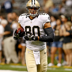 Aug 15, 2014; New Orleans, LA, USA; New Orleans Saints tight end Jimmy Graham (80) warms up before a preseason game against the Tennessee Titans at Mercedes-Benz Superdome. Mandatory Credit: Derick E. Hingle-USA TODAY Sports