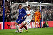 Chelsea FC forward Eden Hazard (10) shadows by Mol Vidi midfielder Boban Nikolov (19) during the Europa League match between Chelsea and MOL Vidi at Stamford Bridge, London, England on 4 October 2018.