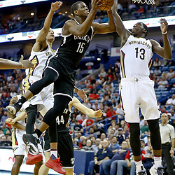 Jan 20, 2017; New Orleans, LA, USA; Brooklyn Nets guard Isaiah Whitehead (15) shoots over New Orleans Pelicans guard Tim Frazier (2) and forward Cheick Diallo (13) during the second half of a game at the Smoothie King Center. The Nets defeated the Pelicans 143-114. Mandatory Credit: Derick E. Hingle-USA TODAY Sports