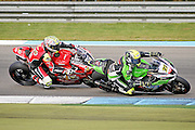 James Ellison (77) JG Speedfit Kawasaki and Shane Byrne (67) Be Wiser Ducati get very close in race1at the BSB Championship at the TT Circuit,  Assen, Netherlands on 2nd October 2016. Photo by Nigel Cole.