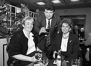 Canal Festival At Newry.  (R77)..1988..04.05.1988..05.04.1988..4th May 1988..Today saw the announcement of the details of the Guinness Canal Festival at Newry. The festival will incorporate the Ulster Final of the Rose of Tralee Contest. The festival, in its fourteenth year, promotes a warm friendly athmosphere with the emphasis on family entertainment. The Festival details were launched at the Guinness Reception Centre,Guinness Brewery, St James's Gate,Dublin...Image shows members of the Newry Festival organising committee in Guinness Brewery enjoying a quiet drink at the launch of the Festival.