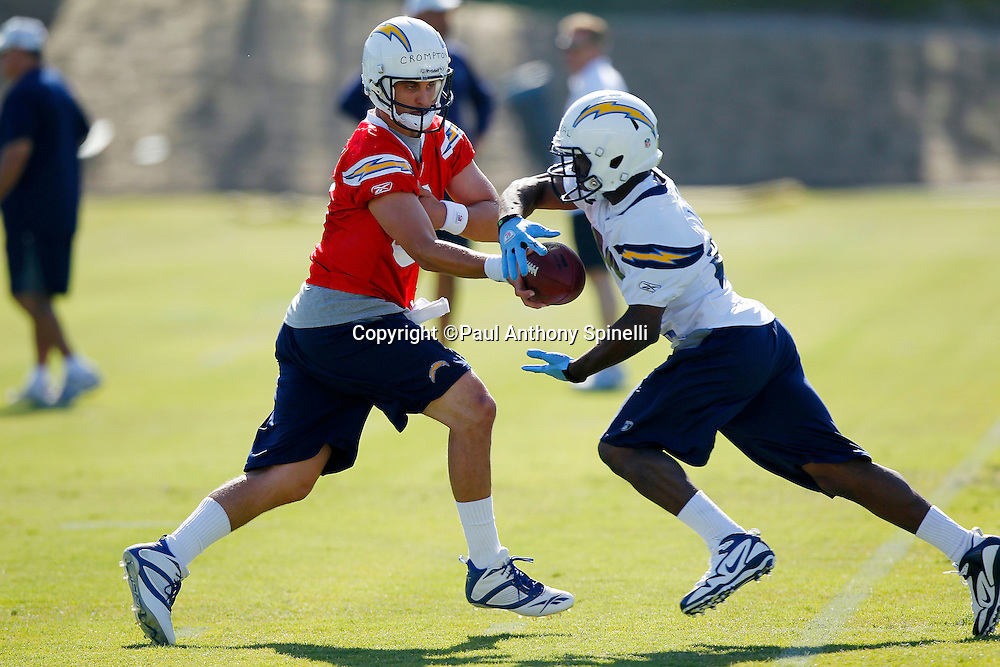 San Diego Chargers rookie quarterback Jonathan Crompton (8) hands off the ball to rookie running back Shawnbrey McNeal (40) during a Chargers rookie minicamp on May 7, 2010 in San Diego, California. (©Paul Anthony Spinelli)