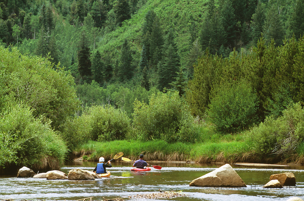 350430-1014 ~ Copyright: George H. H. Huey ~ Kayak practice in the North Star Nature Preserve, near Aspen. White River National Forest in the background. Colorado.