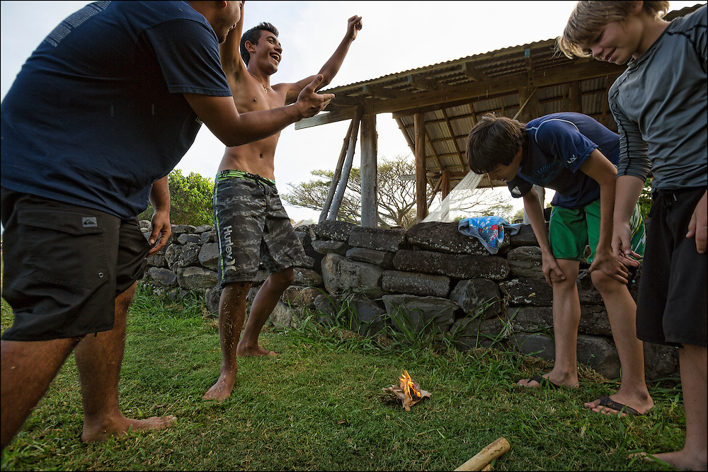Kai Kahoaliki Fonseca celebrates making fire.