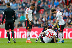 Marcus Rashford of Manchester United is attended to by the physio before going off injured - Mandatory byline: Rogan Thomson/JMP - 21/05/2016 - FOOTBALL - Wembley Stadium - London, England - Crystal Palace v Manchester United - FA Cup Final.