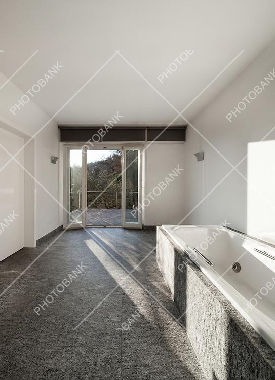 Interior, modern bathroom of an house, bathtub view