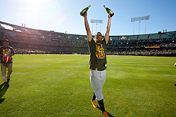 OAKLAND, CA - SEPTEMBER 22: Josh Reddick #16 of the Oakland Athletics celebrates in the outfield after the game against the Minnesota Twins at O.co Coliseum on September 22, 2013 in Oakland, California. The Oakland Athletics defeated the Minnesota Twins 11-7 as they clinched the American League West Division. (Photo by Jason O. Watson/Getty Images) *** Local Caption *** Josh Reddick