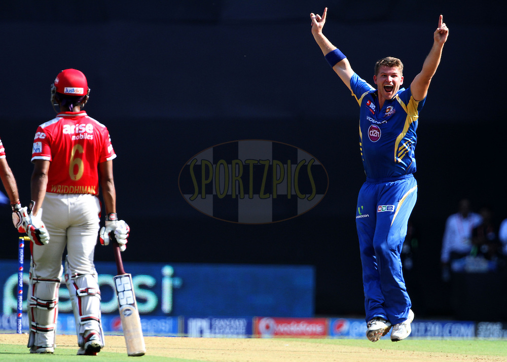Corey Anderson of the Mumbai Indians  celebrates after getting the wicket of Cheteshwar Pujara of the Kings X1 Punjab during match 22 of the Pepsi Indian Premier League Season 2014 between the Mumbai Indians and the Kings XI Punjab held at the Wankhede Cricket Stadium, Mumbai, India on the 3rd May  2014<br /> <br /> Photo by Vipin Pawar / IPL / SPORTZPICS<br /> <br /> <br /> <br /> Image use subject to terms and conditions which can be found here:  http://sportzpics.photoshelter.com/gallery/Pepsi-IPL-Image-terms-and-conditions/G00004VW1IVJ.gB0/C0000TScjhBM6ikg