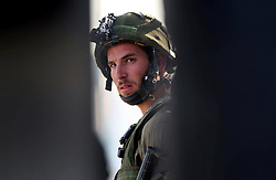 16.10.2015, Bethlehem, PSE, Gewalt zwischen Palästinensern und Israelis, im Bild Zusammenstösse zwischen Palästinensischen Demonstranten und Israelischen Sicherheitskräfte // A member of Israeli security forces looks on during clashes with Palestinian protesters at the main entrance of the West Bank city of Bethlehem on October 16, 2015. The unrest that has engulfed Jerusalem and the occupied West Bank, the most serious in years, has claimed the lives of 35 Palestinians and seven Israelis. The tension has been triggered in part by Palestinians' anger over what they see as increased Jewish encroachment on Jerusalem's al-Aqsa mosque compound, Palestine on 2015/10/16. EXPA Pictures © 2015, PhotoCredit: EXPA/ APAimages/ Muhesen Amren<br /> <br /> *****ATTENTION - for AUT, GER, SUI, ITA, POL, CRO, SRB only*****