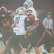 03 September 2016: The San Diego State Aztecs football team open's up the season at home against the University of New Hampshire Wildcats. Defensive linemen Kyle Kelley (59) hits the quarterback in the first quarter of the game. Aztecs lead 21-0 at halftime.  www.sdsuaztecphotos.com