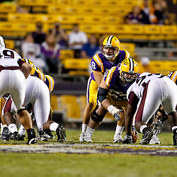 November 13, 2010; Baton Rouge, LA, USA; LSU Tigers quarterback T.C. McCartney (8) under center during the fourth quarter against the Louisiana Monroe Warhawks at Tiger Stadium. LSU defeated Louisiana-Monroe 51-0.  Mandatory Credit: Derick E. Hingle