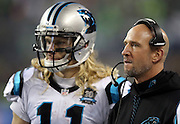 Carolina Panthers wide receiver Brenton Bersin (11) looks on from the sideline with Carolina Panthers wide receivers coach Ricky Proehl during the NFL week 19 NFC Divisional Playoff football game against the Seattle Seahawks on Saturday, Jan. 10, 2015 in Seattle. The Seahawks won the game 31-17. ©Paul Anthony Spinelli