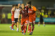 Brian Galach (Crawley Town) celebrates the win for Crawley with David Sesay (Crawley Town) following the EFL Cup match between Crawley Town and Norwich City at The People's Pension Stadium, Crawley, England on 27 August 2019.