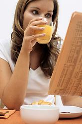 Dec. 14, 2012 - Woman reading at breakfast (Credit Image: © Image Source/ZUMAPRESS.com)