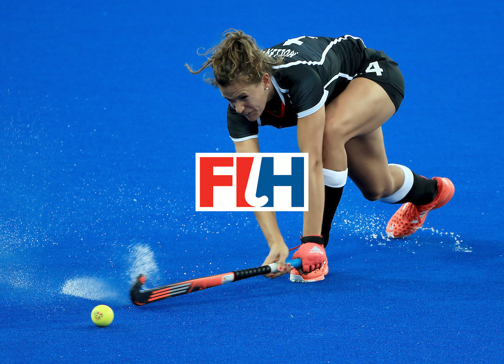 RIO DE JANEIRO, BRAZIL - AUGUST 11:  Nike Lorenz #4 of Germany makes pass during a Women's Preliminary Pool A match against Spain at the Olympic Hockey Centre on August 11, 2016 in Rio de Janeiro, Brazil.  (Photo by Sam Greenwood/Getty Images)