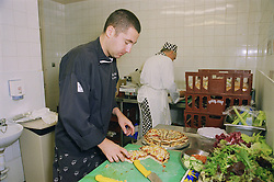 Chef preparing food in hospital kitchen for functions,