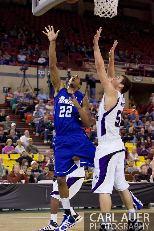 November 27th, 2010:  Anchorage, Alaska - Drake Bulldog Kraidon Woods (22) elevates for a shot in the Bulldog 81-82 loss to Weber State in the third place game of the Great Alaska Shootout.