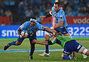 PRETORIA, South Africa, 18 MAY 2013 : Josh Bekhuis of the Highlanders is handed off by Chiliboy Ralepelle of the Bulls with his captain, Pierre Spies in support during the SupeRugby match between the BULLS and the HIGHLANDERS at Loftus Versfeld in Pretoria, South Africa on 18 MAY 2013. Bulls 35 - 18 Highlanders.<br /> <br /> © Anton de Villiers / SASPA