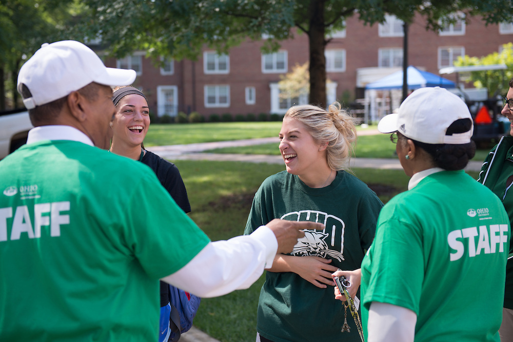 Ohio University students Katie Lally (Left) and Nora Kornelakis (Center) talk with Ohio University President  Roderick McDavis (Left) and First Lady Deborah McDavis (Right) while they help first year students move into their  residence halls. Photo by Ben Siegel