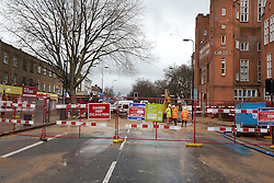 © Licensed to London News Pictures. 28/02/2014. London, UK. The site of a burst watermain is seen on Clapham Road in Kennington London today (28/02/2014). The watermain, which burst yesterday evening flooding a section of Clapham Road - a major in and out of the city - with thousands of litres of water, has today caused widespread disruption to traffic. Photo credit: Matt Cetti-Roberts/LNP