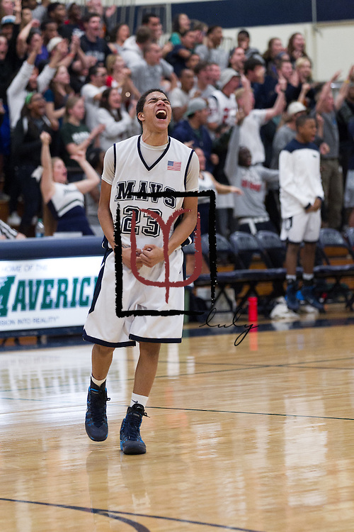 McNeil's Alex Cage celebrates a basket against Cedar Ridge Friday at home.  (LOURDES M SHOAF for Round Rock Leader.)