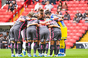 Leeds United players huddle during the EFL Sky Bet Championship match between Barnsley and Leeds United at Oakwell, Barnsley, England on 15 September 2019.