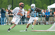 2011/05/22 - RIT's Kelso Davis (in white) drives to the goal in the first quarter of the NCAA Division-3 semifinal against Tufts University. Tufts defeated RIT 16-12 to advance to the National Championship against Salisbury.