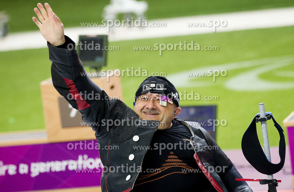 Third placed Josef Neumaier of Germany celebrates after the Men's R1-10m Air Rifle Standing shooting Final during Day 3 of the Summer Paralympic Games London 2012 on August 31, 2012, in Royal Artillery Barracks, London, Great Britain. (Photo by Vid Ponikvar / Sportida.com)