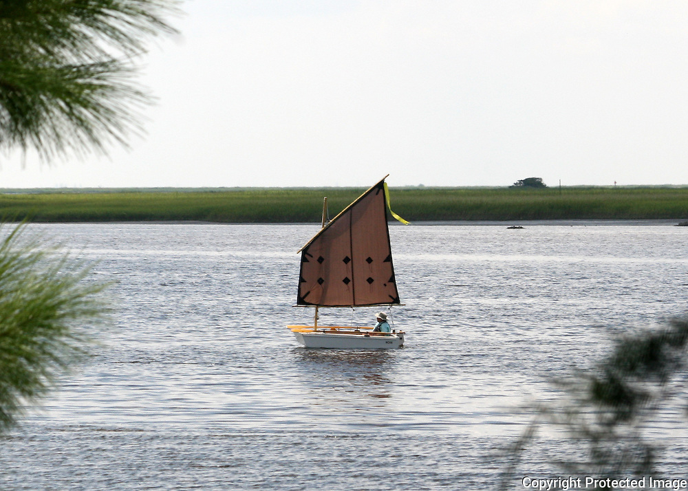 Home made sailboat sailing the inter coastal waterway of Jekyll Island