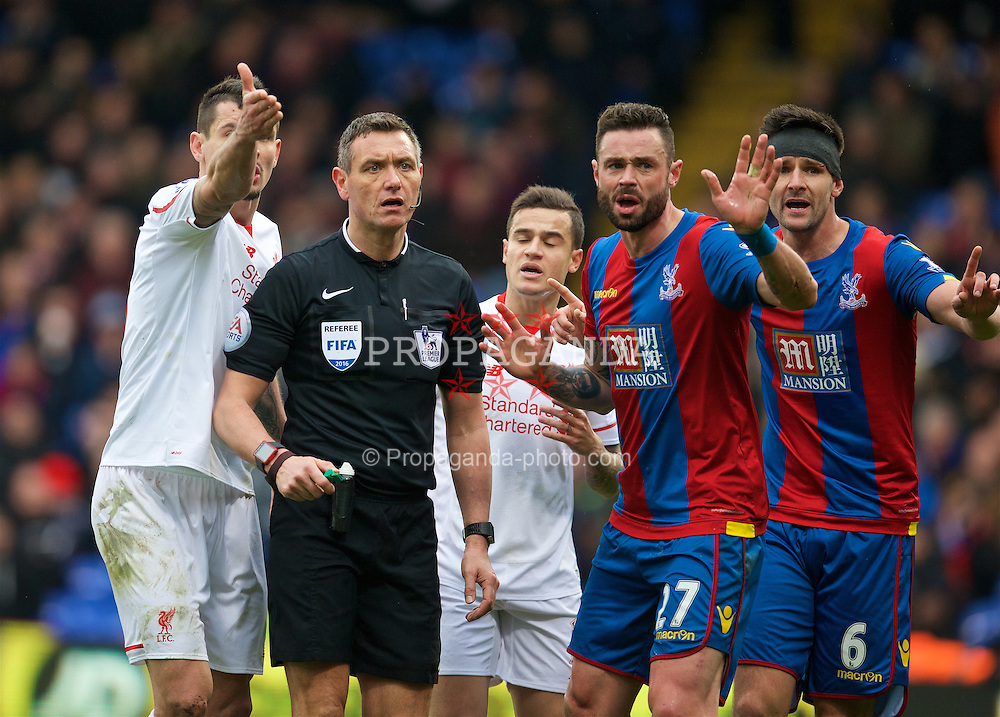LONDON, ENGLAND - Sunday, March 6, 2016: Referee Andre Marriner looks over to his assistant before awarding Liverpool and penalty against Crystal Palace during the Premier League match at Selhurst Park. (Pic by David Rawcliffe/Propaganda)