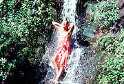 Polynesian woman under Waterfall, Hawaii