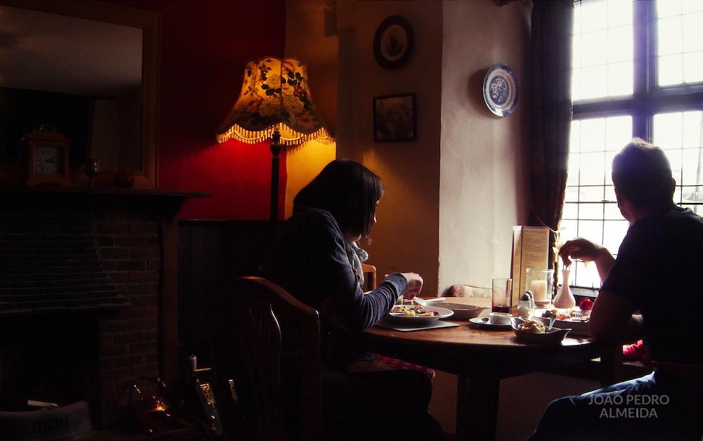 Couple having lunch inside pub