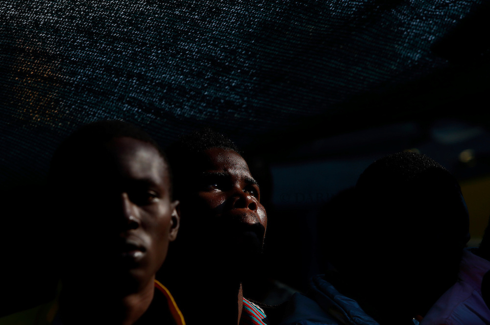 Migrants line up on the deck of the Medecins san Frontiere (MSF) rescue ship Bourbon Argos before disembarking in Trapani, on the island of Sicily, Italy, August 9, 2015.  Some 241 mostly West African migrants on the ship arrived on the Italian island of Sicily on Sunday morning, according to MSF.<br /> REUTERS/Darrin Zammit Lupi <br /> MALTA OUT. NO COMMERCIAL OR EDITORIAL SALES IN MALTA