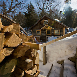 Split logs outside a cabin at Little Lyford Pond Camps near Greenville, Maine.  Winter.