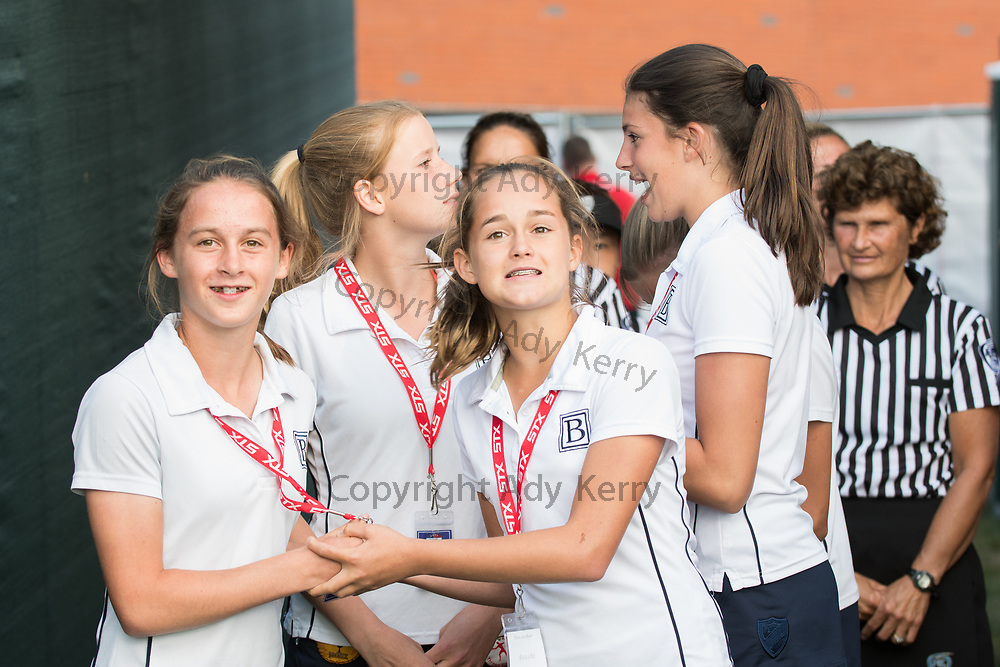 Beneden girls about to carry the trophy for the opening game at the 2017 FIL Rathbones Women's Lacrosse World Cup at Surrey Sports Park, Guilford, Surrey, UK, 15th July 2017