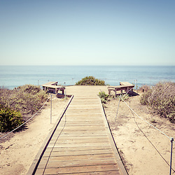 Photo of Crystal Cove State Park seating area overlooking the Pacific Ocean in Laguna Beach in Orange County Southern California.