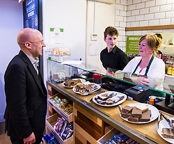 Pictured: Patrick Harvie meets Ross Millar and Bonnie Burton behind the counter.<br /> <br /> Greens co-cordinator Partrick Harvie headed to Rose Street in Edinburgh today to serve customers at Social Bite cafe, a social enterprise supporting the homeless<br /> <br /> Ger Harley | EEm 20 April 2016