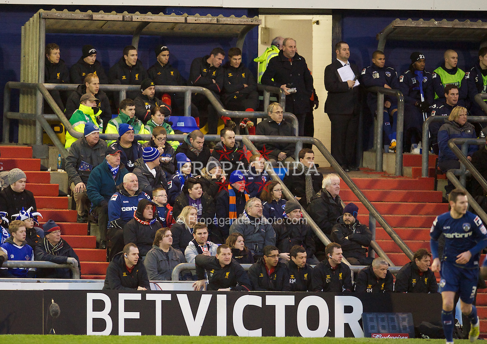 OLDHAM, ENGLAND - Sunday, January 27, 2013: Liverpool's substitutes Jamie Carragher and Steven Gerrard watch during the FA Cup 4th Round match against Oldham Athletic at Boundary Park. (Pic by David Rawcliffe/Propaganda)