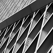 Black and white photograph of the Seattle Public Library Central Library in Seattle, Washington. Designed by architects Rem Koolhaas and Joshua Prince-Ramus of OMA/LMN.